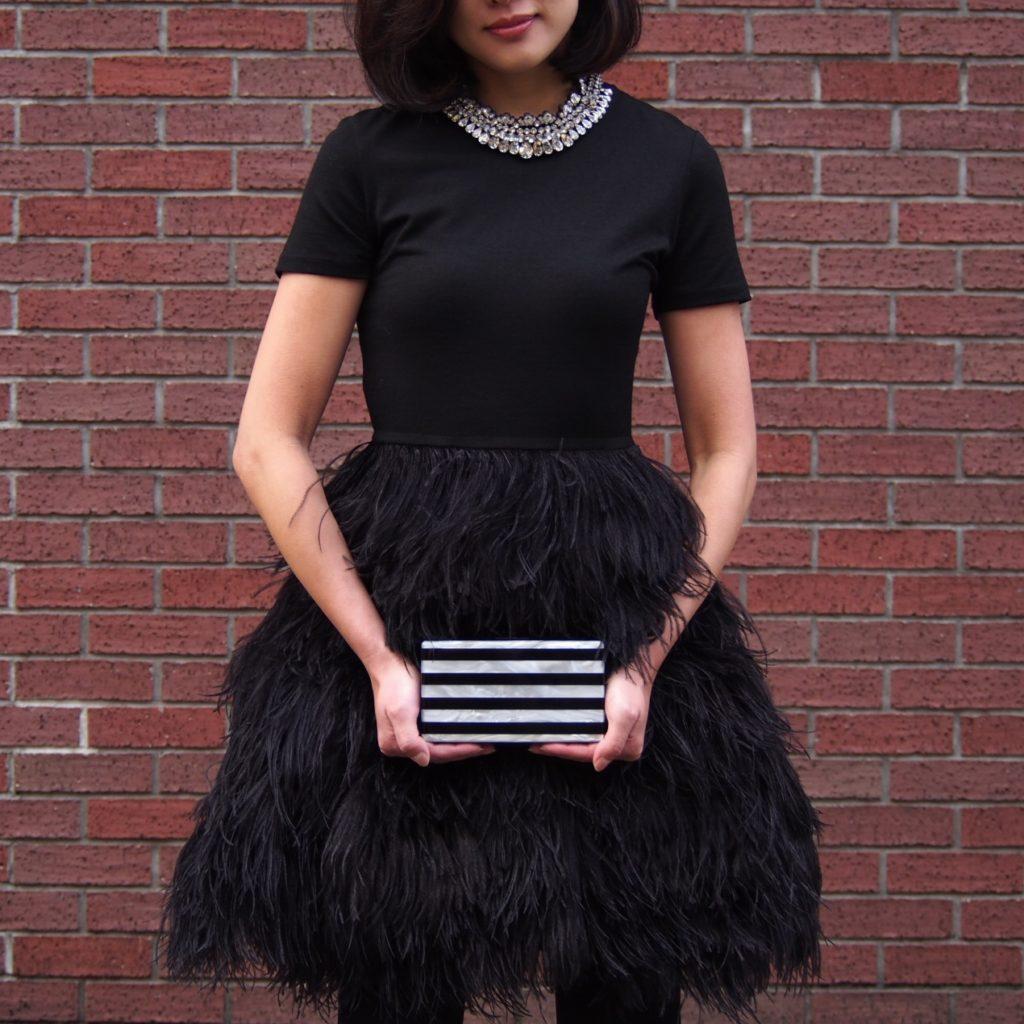 Morgane Le Fay(モーガン・ル・フェイ)のフェザースカートのブラックミニドレス。